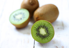 Kiwi fruit on white wooden. Background Stock Photo