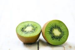 Kiwi fruit on white wooden. Background Royalty Free Stock Images