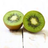 Kiwi fruit on white wooden. Background Stock Photography