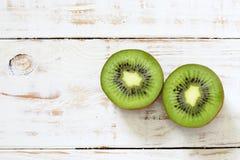 Kiwi fruit on white wooden. Background Royalty Free Stock Image