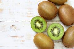 Kiwi fruit on white wooden Royalty Free Stock Photos