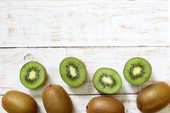 Kiwi fruit on white wooden. Background Stock Images