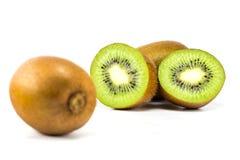 Kiwi fruit. Whole kiwi fruit and his sliced segments  on white background cutout Royalty Free Stock Photography