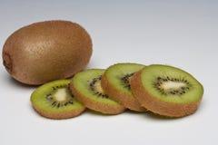 Kiwi Fruit whole and sliced. On a plain background Royalty Free Stock Image