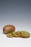 Kiwi Fruit whole and sliced. On a plain background Stock Photography