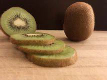 Kiwi fruit on wooden cutting board stock images