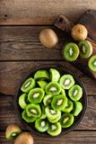 Kiwi fruit on wooden rustic table, ingredient for detox smoothie. Top view royalty free stock images