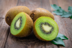 Kiwi fruit on wooden table Royalty Free Stock Images