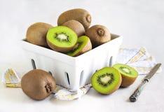 Kiwi fruits in ceramic basket Stock Photo