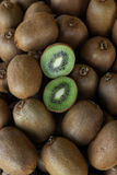 Kiwi fruits on the counter for sale in a vegetable shop. Stock Photo