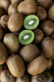 Kiwi fruits on the counter for sale in a vegetable shop. Royalty Free Stock Photos