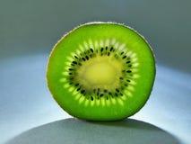Kiwi fruits. Kiwi fruit illuminated by backlight Stock Images