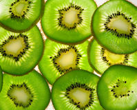 Kiwi fruits illuminated Royalty Free Stock Photos
