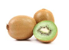 Kiwi fruits and slice. Close-up. White background. Royalty Free Stock Photo