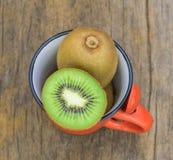 Kiwi  fruits   on  wood background Stock Images