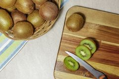 Kiwi fruits on a wooden cutting board royalty free stock photos