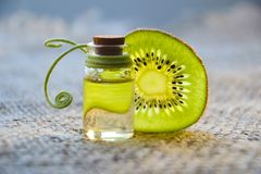 Kiwi Beside Glass Bottle Royalty Free Stock Image
