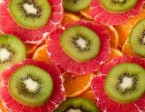 Kiwi, grapefruit and orange Stock Photos