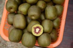 Kiwi. Green fresh kiwi fruit cut on pile of kiwis royalty free stock image