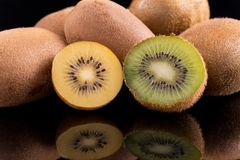 Kiwi green and kiwi gold Royalty Free Stock Photography