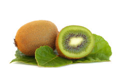 Kiwi and green leaves Stock Photo