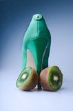 Kiwi with a green shoe Stock Photos