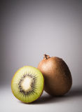 Kiwi on grey background Stock Image