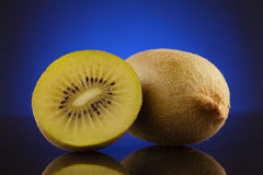 Kiwi and a half on blue Stock Image