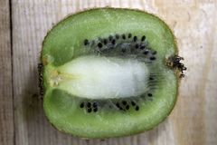 Kiwi half cut lies on the table royalty free stock images