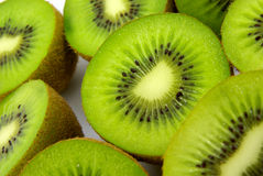 Kiwi halves close-up. Studio shot of kiwi fruit halves stock image