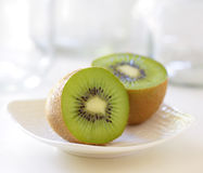 Kiwi halves on a dish Royalty Free Stock Photos