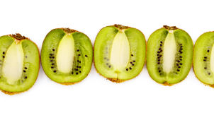 Kiwi halves laying in row Royalty Free Stock Images