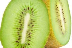 Kiwi halves. Two kiwi fruit halves isolated on white background Stock Photography