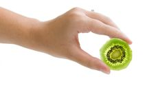Kiwi in hand. A hand holding a backlit slice of kiwi Stock Images