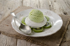 Kiwi ice cream on meringue Stock Image