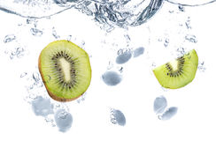 Kiwi And Ice Cubes Splash Royaltyfri Fotografi