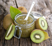 Kiwi jam. Fresh kiwi jam on wooden ground Stock Images