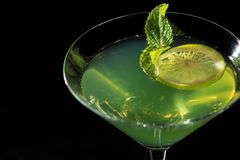 Kiwi jelly with lime pieces in the glass topped mint leaves Stock Photo