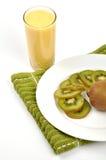 Kiwi juice. Slice pieces of kiwi fruits on plate with juice Stock Photography