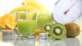Kiwi juice poured in glass, fruit meter scales diet food stock video footage