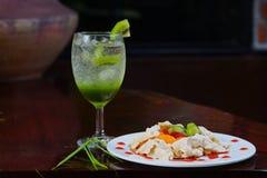 Kiwi juice Soda on glass and bakery.  Stock Images