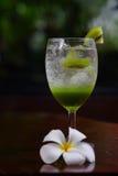 Kiwi juice Soda on glass and bakery.  Royalty Free Stock Image