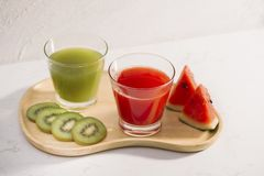 Kiwi juice and watermelon with fruit Slices on wooden tray.  royalty free stock image