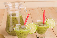 Kiwi juice on the wood Royalty Free Stock Images