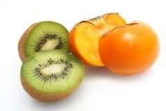 Kiwi & kaki fruit Royalty Free Stock Photos