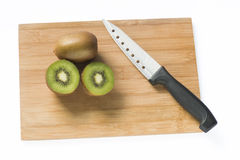 Kiwi and knife. Kiwi fruit and knife on white stock photo