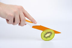 Kiwi and knife Royalty Free Stock Images