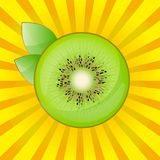 Kiwi with leaves on a bright yellow background Royalty Free Stock Photography