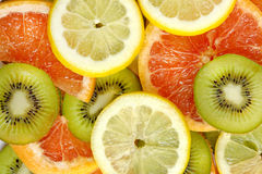 Kiwi, lemon and grapefruit mix background Stock Images