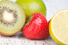 Kiwi, lemon, lime and strawbery Royalty Free Stock Photo